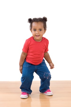 Adorable african baby dancing over wooden floor