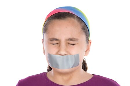 Beautiful girl with adhesive on her mouth and closed eyes isolated over white Stock Photo - 4170587