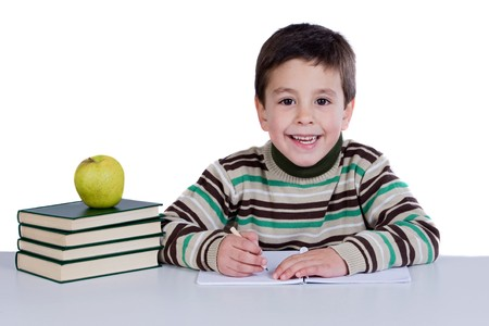 Adorable child writing in the school on a over white background Stock Photo - 4170604