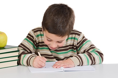 kids writing: Adorable child writing in the school on a over white background