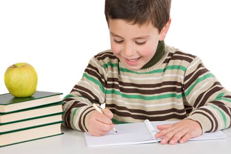 Adorable child writing in the school on a over white background