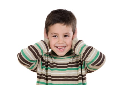 noise isolation: Adorable child stoppering his ears on a over white background Stock Photo