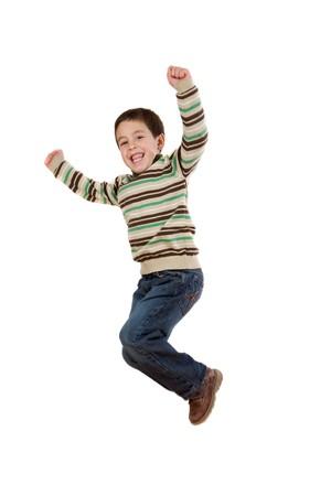 Joyful little girl jumping on a over white background