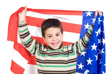 Adorable boy with american flag isolated over white photo
