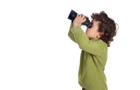 Adorable spy boy with binoculars isolated over white photo