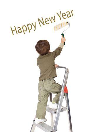 Adorable boy writing congratulation on a over white background  photo