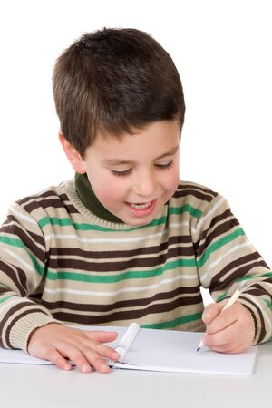 sympathetic: Adorable child writing in the school on a over white background