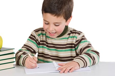 emotional intelligence: Adorable child writing in the school on a over white background