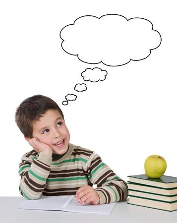 inteligencia emocional: Adorable ni�o a pensar en la escuela en m�s de un fondo blanco Foto de archivo