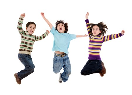 Three happy children jumping at once on a white background Stock Photo