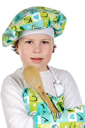 playing with spoon: Adorable future cook a over white background Stock Photo