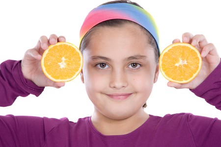 Cute girl playing with oranges a over white background Stock Photo - 4191897