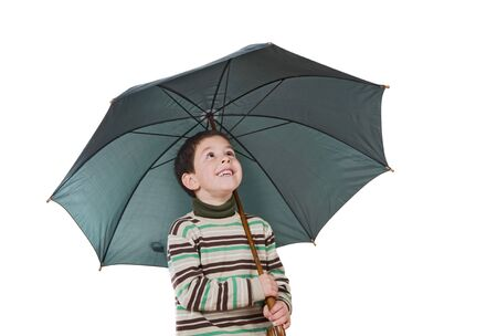sympathetic: Adorable boy with open umbrellas isolated over white