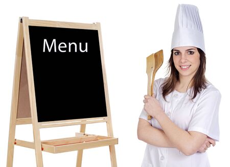 announcing: Adorable cook with a blackboard announcing the menu Stock Photo