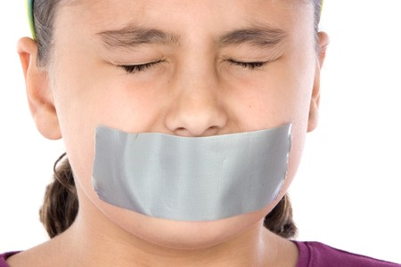 Beautiful girl with adhesive on her mouth and closed eyes isolated over white photo