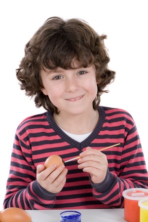adorning: Child adorable adorning Easter eggs on a white background