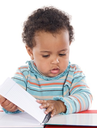 Adorable baby studying a over white background photo