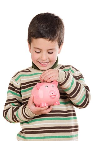 Adorable child with moneybox savings isolated over white photo