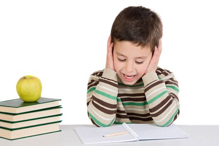 Adorable child studying with books and apple on a over white background photo