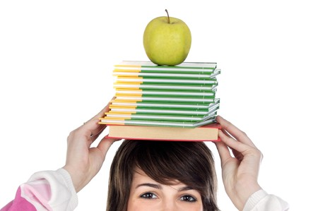 Girl with books and apple on the head isolated over white  photo