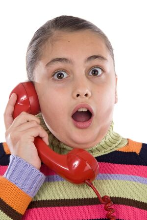 Beautiful girl with red telephone very happy for good news isolated over white photo