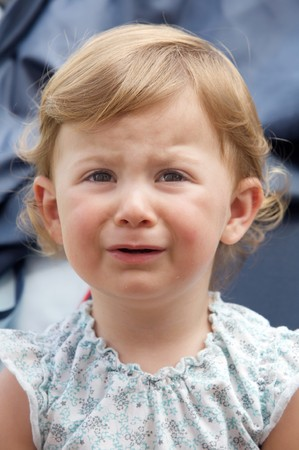 Photo of a beautiful baby caucasian girl crying photo