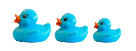 Family of three blue plastic duck on a over white background Stock Photo - 4333428