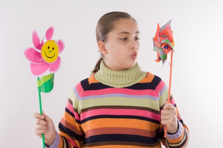 Girl with two windmill in her hands Stock Photo - 4363152