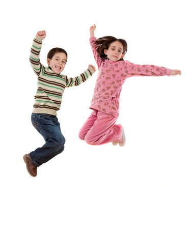leaping: Two happy children jumping at once on a white background