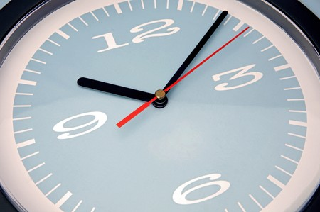 Macro of a clock with blue background Stock Photo - 4333485