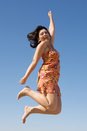 flying hair: Beautiful girl flying a over sky background Stock Photo