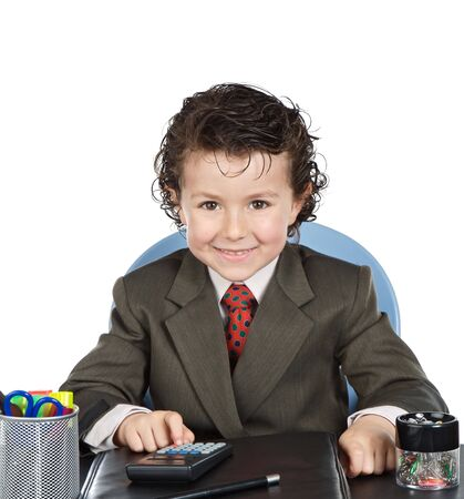 Adorable future businessman in the office on a over white background photo