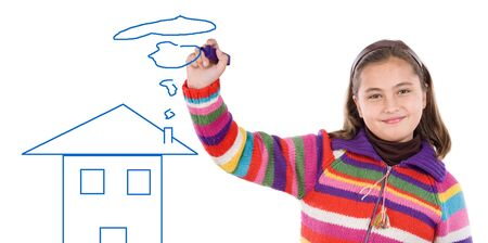 Adorable girl drawing a house on a over white background photo