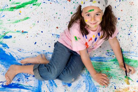 Girl playing with painting with the background painted Stock Photo - 4357105