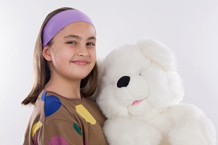 Little girl with her big teddy bear  photo
