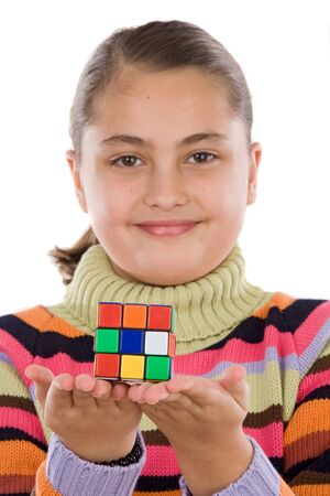 Little girl playing with a colorfull cube isolated over white photo