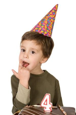 chocolaty: Beautiful boy celebrating his birthday isolated over white