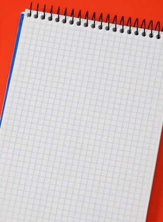 Photo of one notebook in blank with blue squares isolated over red Stock Photo - 4425621
