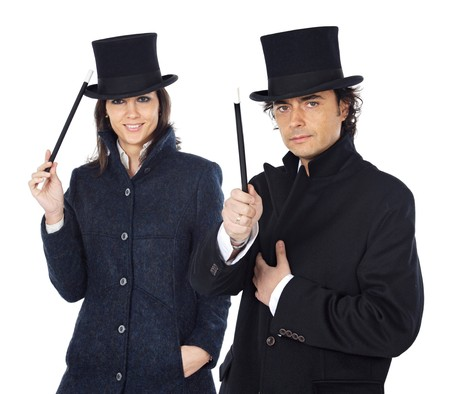Attractive couple with a magic wand and hat on a over white background photo