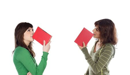 Two young girls thinking with books isolated over white photo