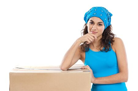 Attractive woman with box making a removal photo