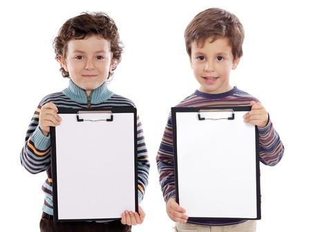 ni�os con l�pices: Dos hermosos ni�os estudiante con el Bloc de notas (puedes poner el texto) Foto de archivo