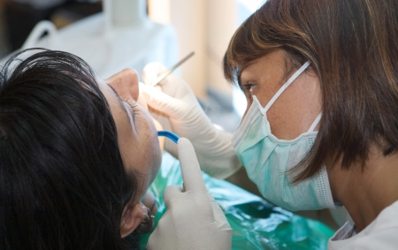 dental nurse: consulting a dentist during a dental cleaning Stock Photo