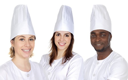 Team of three chefs on a over white background photo