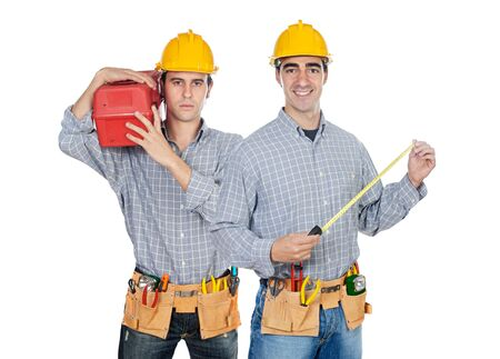 Two construction workers on a over white back ground photo