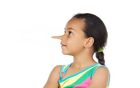 to lie: Little girl with long nose thinking lies on a white background Stock Photo