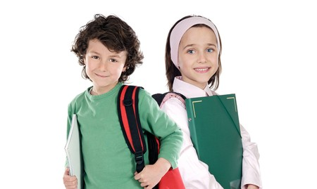 Two students returning to school on a white background photo