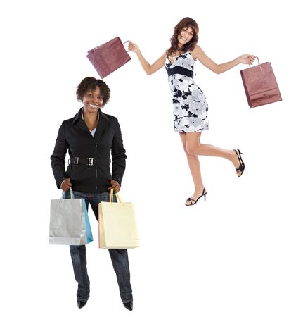 Two girls shopping on a over white background photo