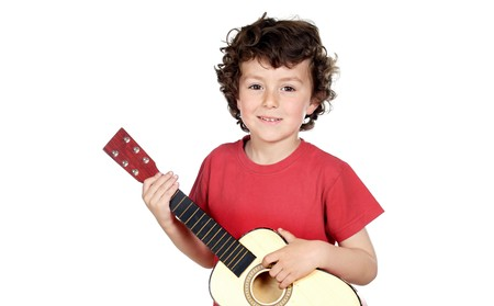 Adorable child playing guitar a over white background photo