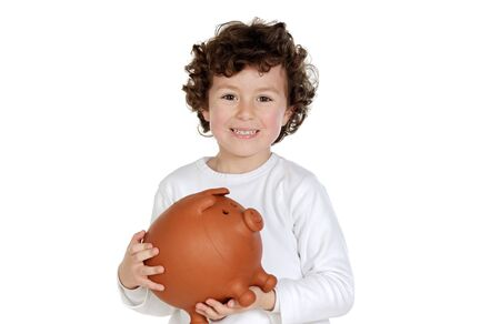 thrift box: adorable child with its savings in its moneybox of piggy a over white background Stock Photo